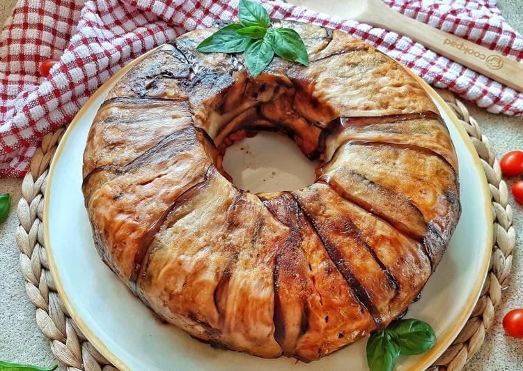 timballo-di-melanzane-e-anelletti-siciliani-recipe-main-photo-1613399319.jpg